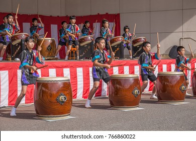 YAMAGUCHI, JAPAN - NOVEMBER 3, 2017: Children play taiko drums in the Chomonkyo Red Maple Festival, a non-ticketed, free, public festival. Their light kimonos read: 'Ato Town Dream Taiko Drum Club.'