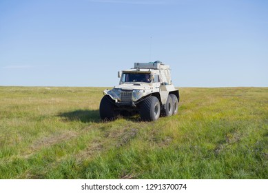 YAMAL, RUSSIA - AUGUST 22, 2018: Trakol all-terrain vehicle moves along the tundra on a sunny summer day