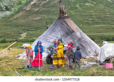 YAMAL, RUSSIA - AUGUST 23, 2018: A large family of Khanty reindeer herders near the choom