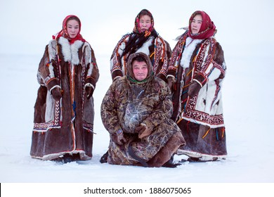 Yamalo-Nenets Autonomous Okrug, extreme north, Nenets family in the national winter clothes of the northern inhabitants of the tundra, the Arctic circle