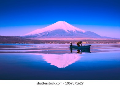 YAMANAKA, JAPAN - APR 3: A man is preparing for fishing at lake Yamanaka, April 3, 2018 in Japan. Fishing is a traditional Japanese activity. Yamanaka is one of the best place to enjoy it.