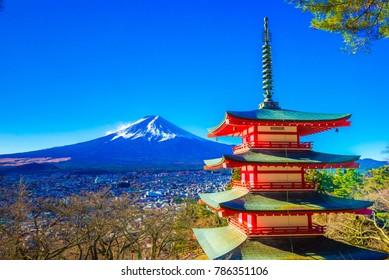 Yamanashi, Japan - December 28, 2017 : Mount Fuji and Chureito Pagoda. Chureito pagoda is located at Asakurayama in Fujiyoshida, Japan. Mount Fuji, Fuji san is famous mountain in Japan.