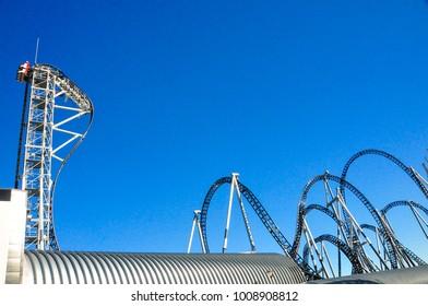 Yamanashi, Japan - December 3, 2013 : Roller coaster railway against clear blue sky at Fuji Q Highland Amusement Park.