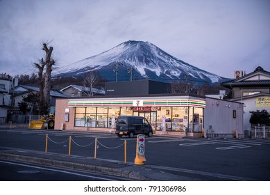 YAMANASHI, JAPAN - January 5 , 2018: Fuji mountain over 7-Eleven convenience store  in Fujiyoshida-shi ,Japan is held by the Seven & I Holdings Co. holding company,