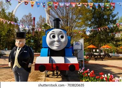 YAMANASHI, JAPAN - MAY 01, 2017: Thomas stream engine and Fat Controller monuments at Thomas land theme park in Fuji-Q Highland amusement park.