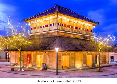 YAMASHIRO ONSEN, JAPAN - JANUARY 9, 2017: The Ko-Soyu bath house at twilight. The bath house was spectacularly rebuilt in the style of its Meiji Period appearance in 2010.