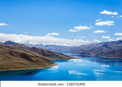 "Yamdrok lake""the fifth largest lake in the Tibet,China.beautifual blue lake on Highest land with mountains under blue sky and white clouds.Landmark of Tibet."