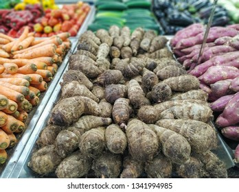 yams for sale in supermarket in hortifruti section, with blurred background