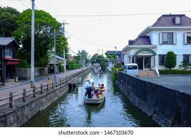 Yanagawa , Japan - August 1st 2019 : Tourists take a canal punting ride at Yanagawa Canals