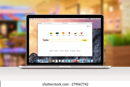 Yandex search web page in Safari browser on the Apple 15 inch MacBook Pro Retina screen. Blurred office space on the background: Varna, Bulgaria - November 03, 2013