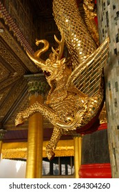 YANGON, BURMA - FEB 18, 2015 -  Dragon guardian of the  Bell of King TharrawaddyShwedagon Pagoda,  Yangon (Rangoon),  Myanmar (Burma)