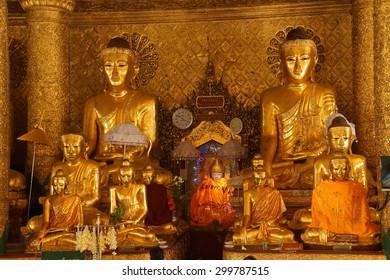 YANGON, BURMA - FEB 18, 2015 -  Buddha in Bhumiparsa Mudra position, Calling the Earth To Witness the Truth, Shwedagon Pagoda Yangon (Rangoon),  Myanmar (Burma)