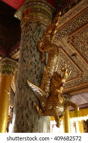 YANGON, BURMA - FEB 18, 2015 - Dragon guardian of the  Bell of King Tharrawaddy, Shwedagon Pagoda,  Yangon (Rangoon),  Myanmar (Burma)