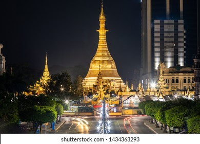 Yangon city downtown at night with famous Sula pagoda.