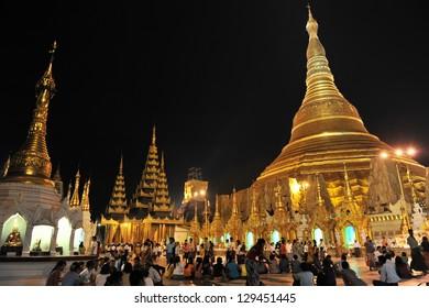 YANGON - FEB 12: Temple-goers visit Shwedagon Pagoda on Feb 12, 2013 in Yangon, Burma. Built between 6th and 10th century Shwedagon is considered Burma's most sacred Buddhist pagoda.