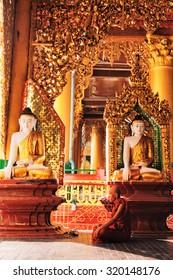 Yangon,  - February 24, 2011 : Monk praying inside Shwedagon Pagoda