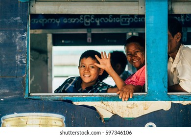 YANGON - JAN 15: Train station in Yangon and waiting passengers. Yangon Circular Railway is the local rail network that serves the Yangon metropolitan area on 15 January, 2017.