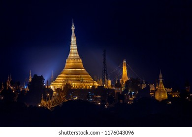 Yangon. Myanmar. 01.23.13. Floodlights illuminate the Shwedagon Pagoda, (officially titled Shwedagon Zedi Daw), a 325 ft gilded pagoda and stupa in the city of Yangon, Myanmar (Burma)