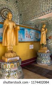 Yangon. Myanmar. 01.24.13. Buddha statues outside the Kaba Aye Pagoda (World Peace Pagoda) in Yangon in Myanmar (Burma).