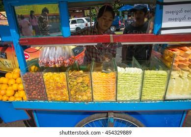 YANGON MYANMAR 10 JANUARY 2015 : Unidentified street vendor sell fruits on 210 JANUARY 2015 at Yangon, Myanmar