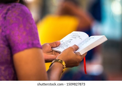 yangon, myanmar. 16 th august, 2019: a woman is reading sanskrit text book