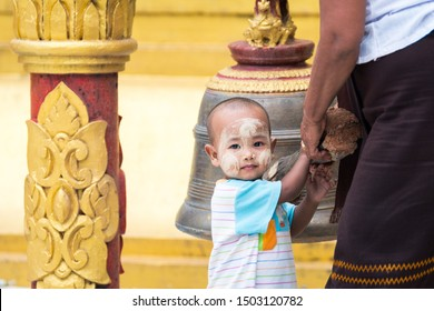 yangon, myanmar. 16th august, 2019: portrait of pretty kids with thanaka cream at face