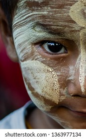 Yangon, Myanmar - 18th November, 2017 : A portrait of a Burmese boy at a school for monks. The boy's face is covered with natural tanaka tree juice for protection from the sun.