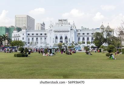 Yangon, Myanmar - 25. December 2016: People in the colonial city center of former capital city of Myanmar.