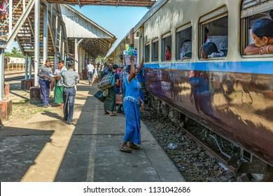 Yangon, Myanmar - 26. December, 2016: People waiting the train in Circle line railway station. Burma Railways is the state-owned agency that operates the railway network in Myanmar.