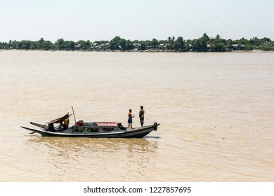 Yangon, Myanmar - Apr 07 2018: Boat floating down Yangon river