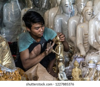 Yangon, Myanmar - Apr 12 2018: yong man polishing Buddha statuette for selling