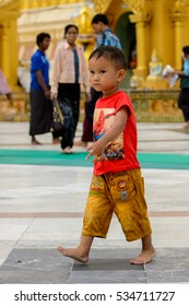 YANGON, MYANMAR - AUG 24, 2016: Unidentified Burmese little boy in a local temple. 68 per cent of Myanma people belong to Bamar ethnic group