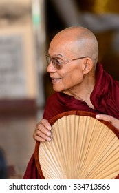 YANGON, MYANMAR - AUG 24, 2016: Unidentified Burmese Buddhist monk in a local temple. 68 per cent of Myanma people belong to Bamar ethnic group