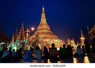 yangon, Myanmar. August 23, 2017. People pay respect to Shwedagon Pagoda. Myanmar famous sacred place and tourist attraction landmark.Golden Shwedagon Pagoda at night time.