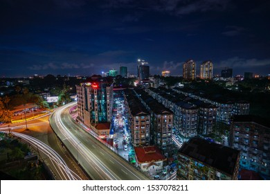 Yangon / Myanmar- August 28 2019: The fly over and long exposure in Yangon downtown with cityscape and skyscrapper in the background