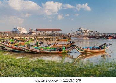 YANGON, MYANMAR - DECEMBER 15, 2016: Wooden boats and a pier at Yangon river in Yangon.