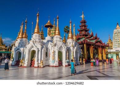 YANGON, MYANMAR - DECEMBER 16, 2016: Shrines at Shwedagon Paya Pagoda in Yangon, Myanmar