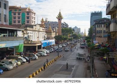 YANGON, MYANMAR - DECEMBER 17, 2016: A street in Yangon in the early morning