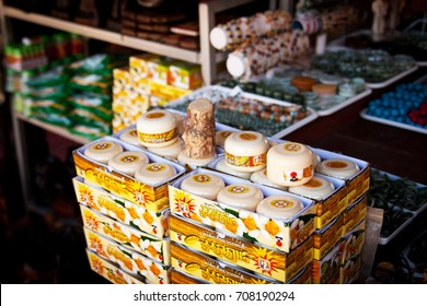 "YANGON, MYANMAR - December 2014: Traditional cosmetics produced from wood called ""Tanaka"". Myanmar cosmetics for sale on the market in Yangon, Myanmar (Burma)"