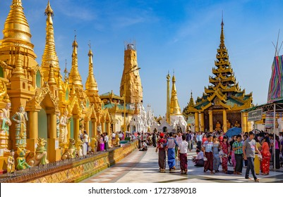 YANGON, MYANMAR - December 25, 2016: Shwedagon pagoda, Yangon, Myanmar. They pour water and make offerings to a Buddha image with a wish for their well being.