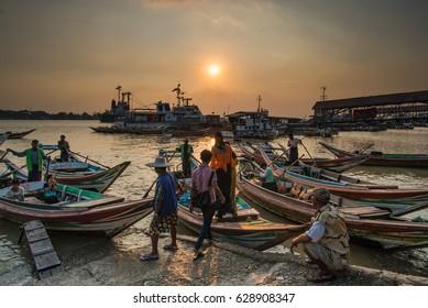 Yangon, Myanmar - December 25, 2016: Public transportation to crossing Yangon river by wooden boat in Yangon, Myanmar.