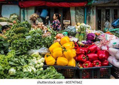 Yangon, Myanmar - December 26, 2016: Morning fresh market with local food from local farming in Yangon, Myanmar.