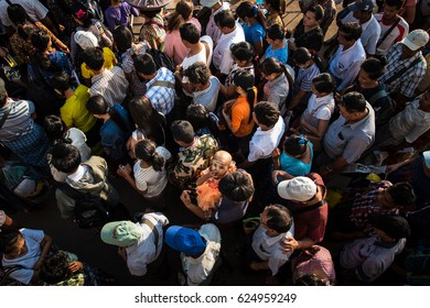 Yangon, Myanmar - December 28, 2016: Crowding of local Burmese people are moving on the way in greater Yangon, Myanmar.