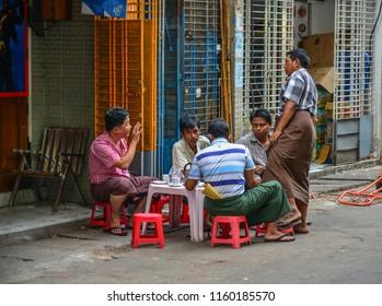 Yangon, Myanmar - Feb 1, 2017. Burmese men drinking coffee on street in Yangon, Myanmar.