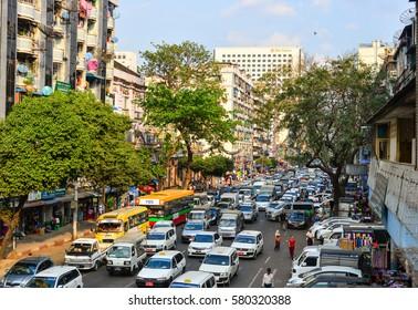 Yangon, Myanmar - Feb 1, 2017. Cars on Bogyoke street in Yangon, Myanmar. Yangon is the country's main centre for trade, industry and tourism.