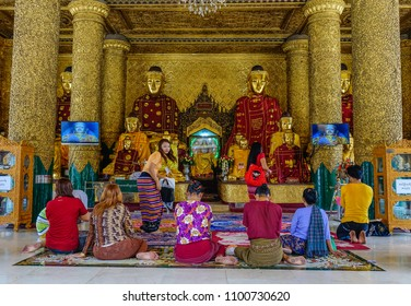 Yangon, Myanmar - Feb 26, 2016. Local people praying at Shwedagon Pagoda in Yangon, Myanmar. Shwedagon is known as the most sacred pagoda in Myanmar.