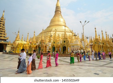 Yangon, Myanmar - Feb 26, 2016. People praying at Shwedagon Pagoda in Yangon, Myanmar. The Shwedagon Pagoda is one of the most famous pagodas in the world.