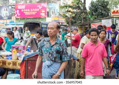 YANGON, MYANMAR â?? FEBRUARY 10: Street scene on Maha Bandoola Road in Chinatown on February 10, 2014 in Yangon. Myanmar is ethnically diverse with 51 million inhabitants belonging to 135 ethnic groups.
