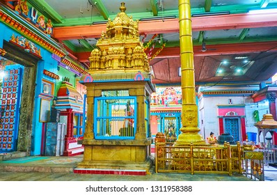 YANGON, MYANMAR - FEBRUARY 15, 2018: The ornate interior decoration of historic Sri Varatha Raja Perumal Hindu Temple with complex carvings and bright patterns, on February 15 in Yangon.