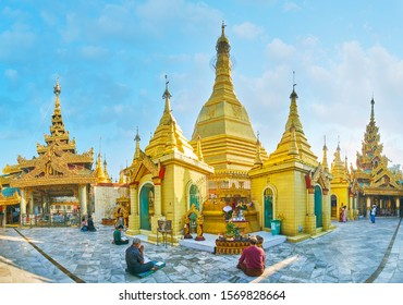YANGON, MYANMAR - FEBRUARY 17, 2018: Morning is perfect time to visit Sule Pagoda, walk its grounds, watch historical shrines, impressive golden stupas and ornate galleries, on February 17 in Yangon